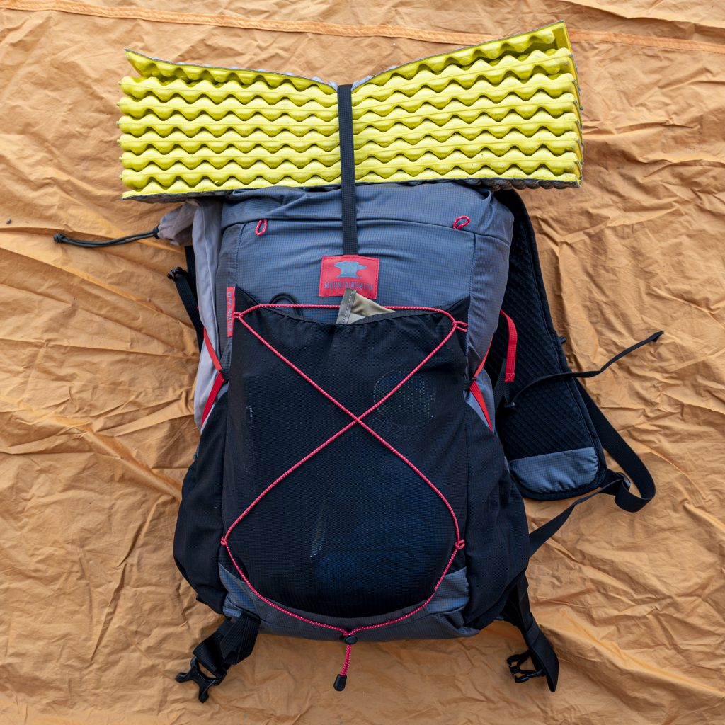 a fully packed backpack ready to hit the trail